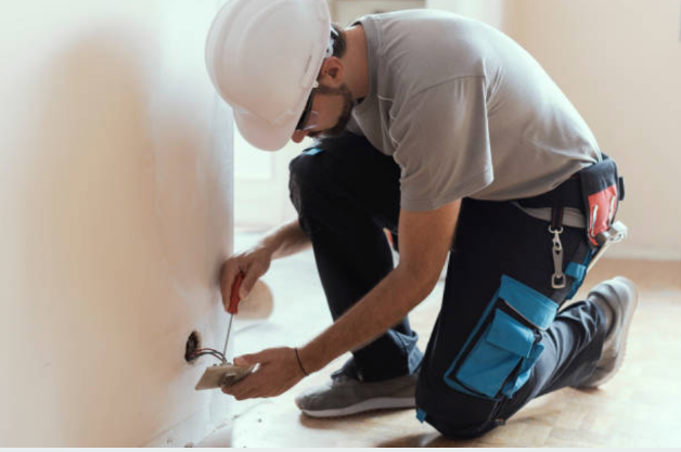 Man working on power outlet