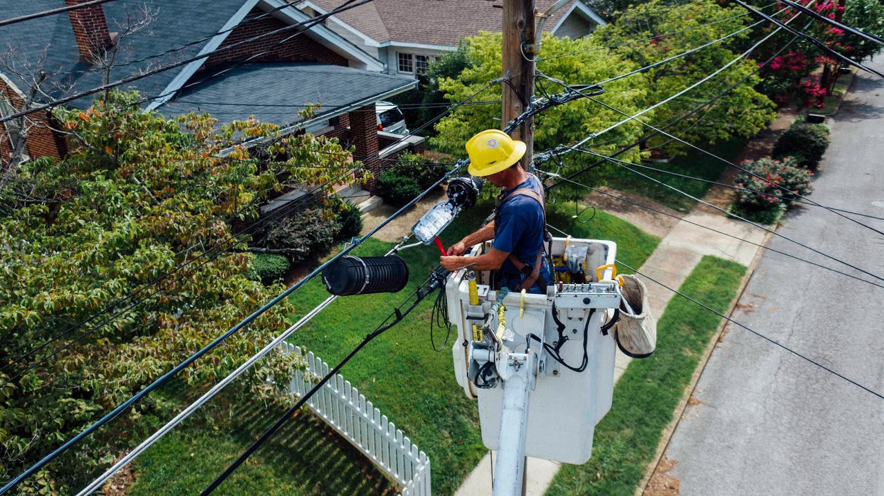 Man repairing electrical wires outdoor